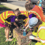 Girl Scouts clean-up, plant flowers downtown
