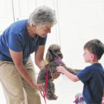 Therapy dogs teach reading and agility