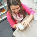 Students at Shoals Elementary School in Pinnacle conduct a science experiment involving the properties of matter