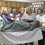 Local volunteers make quilts for homeless