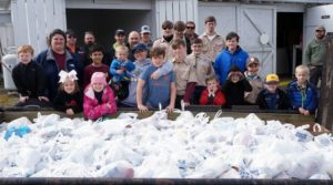 Local Scouts gather food for Outreach Center