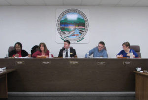 Board moves forward with water, streetscape
